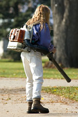 girl using a leaf blower